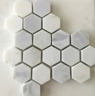 Small hexagon marble tiles. A very popular trend that we are adoring!